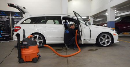 car door panel being cleaned